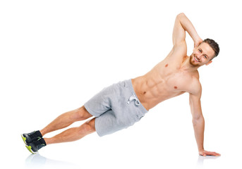 Sport attractive man doing fitness exercises on the white