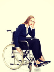 Tired businesswoman on a wheelchair