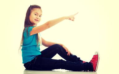 Little girl showing something