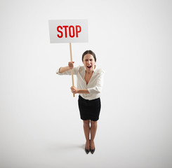 woman holding placard with stop sign