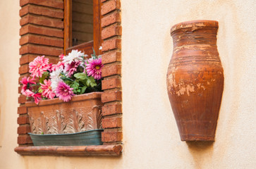 Architectural elements in the wall of a house in Castelmola