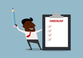 Happy businessman completing a checklist