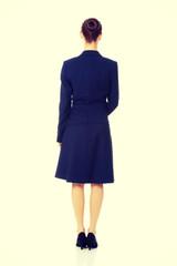 Businesswoman standing back