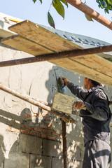 Builder worker plastering