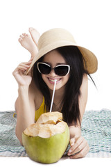 Woman with bikini enjoy coconut water