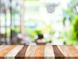 Fototapety Empty tropical wood table and blurred garden cafe light backgrou