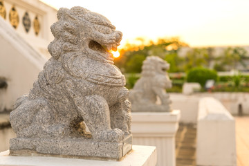 Chinese stone lion with sunset i