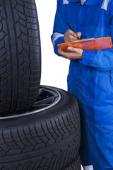 Technician checks tires condition