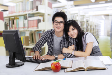 Lovely two students in library