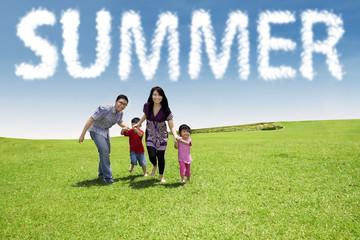 Family enjoy vacation at green meadow