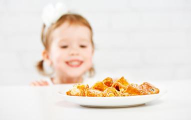 happy child  girl eats biscuits, cookie