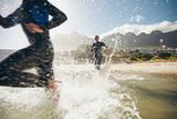 Athletes training for a triathlon - Fine Art prints