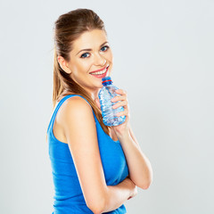 happy woman hold water bottle .