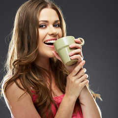 Close up portrait of young woman with coffee cup.