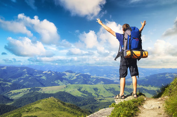 Tourist on mountain peak. Active life concept..