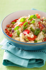 healthy couscous salad with tomato cucumber onion chives