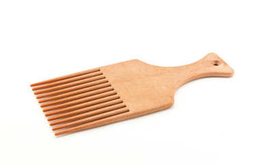 afro pick on white background