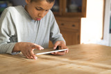 Young boy on tablet pc