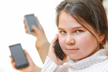 Little girl talking on mobile smartphone