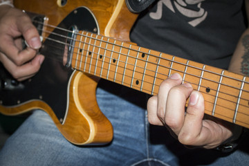 Young man playing electricguitar