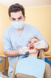 Young male dentist at work