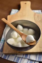 Mozzarella ball on a wooden spoon