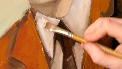View of painter`s work, brown jacket and white shirt of man