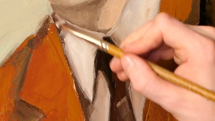 View of painter`s work, brown jacket, tie and white shirt of man