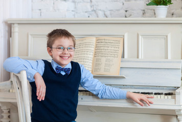 Little boy playing piano at home