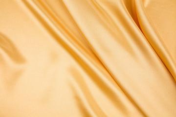 Yellow cloth silk texture close up.