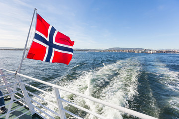 Norwegian flag waving on poop of a boat in Oslo