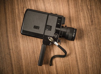 Close up of old fashioned retro 8 mm camera in vintage style