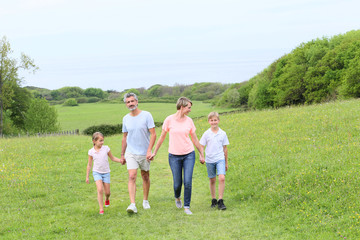 Family walking on country trail during vacation time