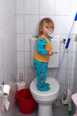 baby in a toilet