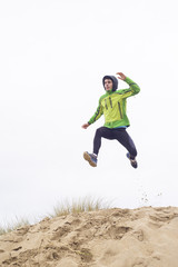 Man practicing trail running on beach