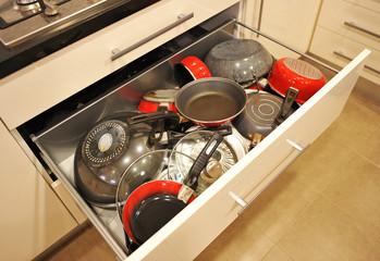 Kitchen drawer full of pans