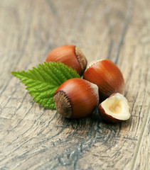 Hazelnuts on a wooden table.