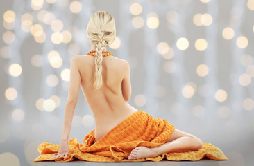 beautiful young woman with orange towel