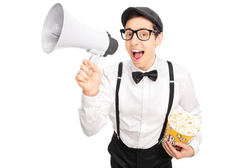 Guy in artistic outfit speaking on a megaphone