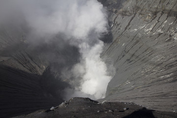 Bromo volcano crater with smoke, Indonesia