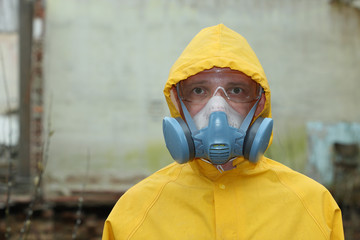 Man with protective  mask and protective clothes explores danger