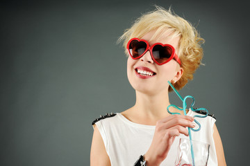 beautiful blond with red sunglasses