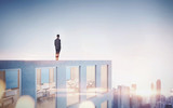 Businessman looking at city in sunrise. 3d rendering