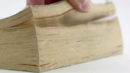 Man's hand scrolls a Book, focus on the front