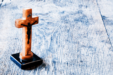 Beautiful old cross with jesus on the old wooden floor