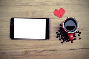 Cup of coffee with coffee beans and tablet