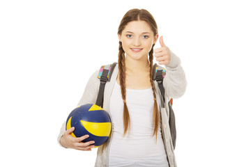 Young woman with volley ball.