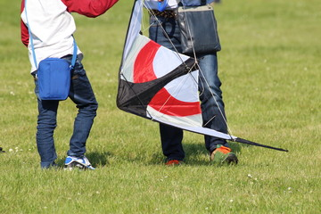 A boy and his dad who prepare the kite