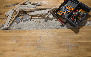 Tool box on damaged wooden floor with space for your text.