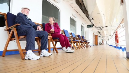 Senior Couple Relaxing on Deck of Luxury Cruise Ship